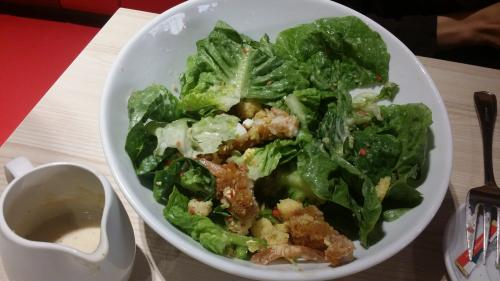 Caesar salad with breaded chicken.